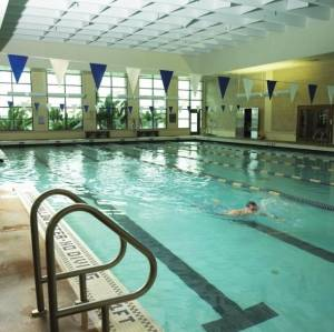 Student make use of the pool in the University's state-of-the-art gym, the Herbert Wellness Center.