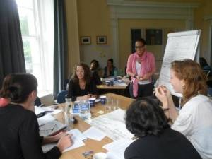Students in the TJI seminar room during one of our Summer Schools