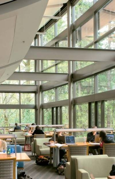 Law students preparing for class in the beautiful reading room looking out on Tryon Creek State Park