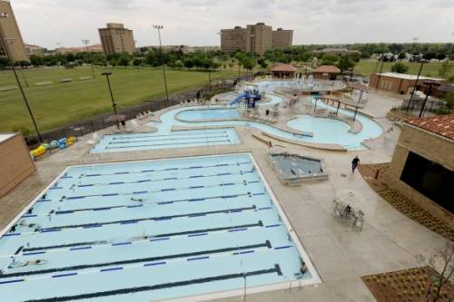The Student Leisure Pool is the largest pool of its kind on a college campus in the United States. Located across the street from the law school, the two-acre leisure pool complex features a 645 foot long lazy river, a large hot tub, water volleyball and basketball areas, a snack bar and other amenities.