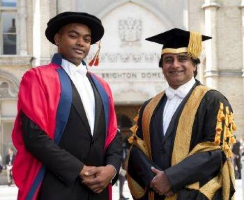 Chancellor Bhaskar congratulates the new doctor