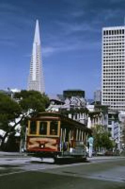 San Francisco cable car on a hill overlooking the Financial District.