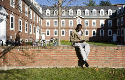 A student studies outside Blakeley Hall