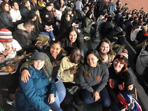 International students at a San Francisco Giants baseball game.